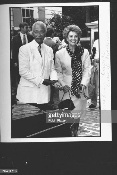 NYC Mayor David Dinkins w Matilda Cuomo wife of NY Gov Mario Cuomo arriving at the Reebok party for Dem supporters during the wk of the Dem Natl...