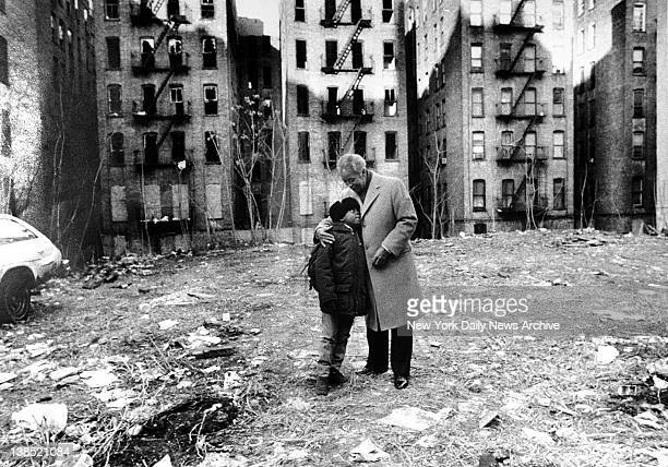 Mayor David N Dinkins embraces a young boy near abandoned buildings in the South Bronx Born July 10 in Trenton NJ he attended Howard University and...