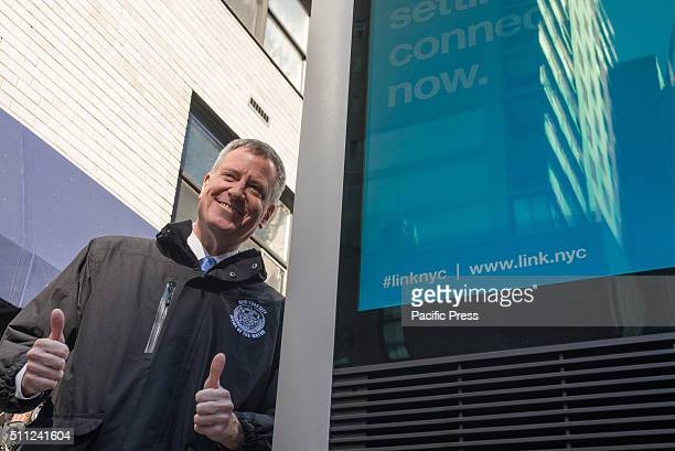 Mayor de Blasio gives gives a 'thumbs up' after speaking with a 311 operator during a test of the system before the press conference Mayor Bill de...