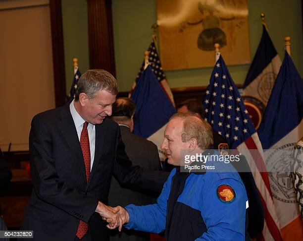 Mayor de Blasio with first responder after key ceremony Mayor de Blasio gathered with fire fighters in city council chambers to celebrate extension...