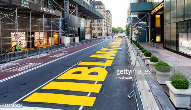 mayor deblasio has black lives matter painted in front of trump towers on 5th avenue in manhattan, nyc - anti racism stock pictures, royalty-free photos & images