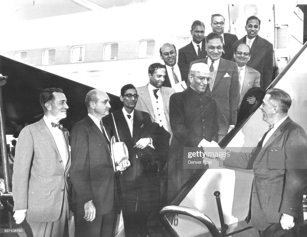 Mayor Dick Batterton shakes hands with India's finance minister Morarji Desai, as he welcomes Desai and his party of India economic officials to Denver for a two-hour tour during stopover at Stapleton Field Sunday. Credit: Denver Post