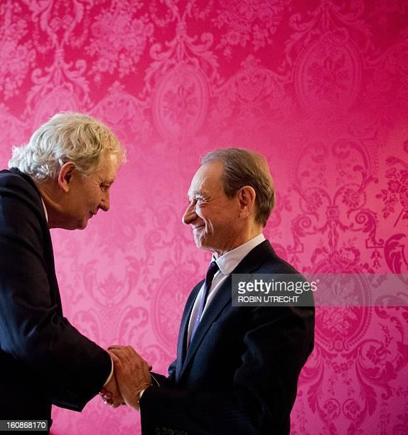 Mayor Eberhard van der Laan of Amsterdam and his Parisian counterpart Bertrand Delanoe shake hands during the signing of a partnership agreement in...