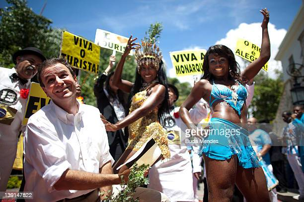 Mayor Eduardo Paes clebrates with samba dancers Beija from Flor Samba School during the official opening of Carnivalon Frebuary 17 2012 in Rio de...