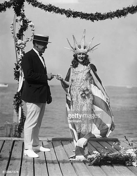 Mayor Edward L. Bader hands the key to the city to the first crowned Miss America, Margaret Gorman, in Atlantic City.