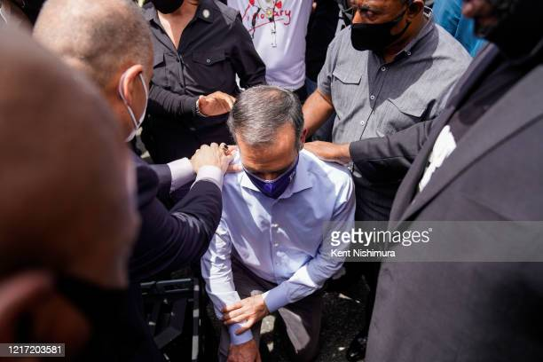 Mayor Eric Garcetti walks out to address protesters and clergy members from the Los Angeles area that are participating in a march and peaceful...