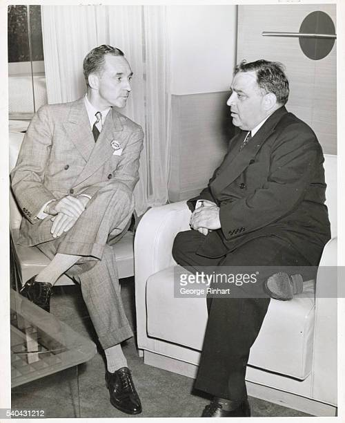 Mayor Fiorello La Guardia speaking with the president of the Ford Motor Company Edsel Ford at the Ford Exposition at the New York Fair celebrating...