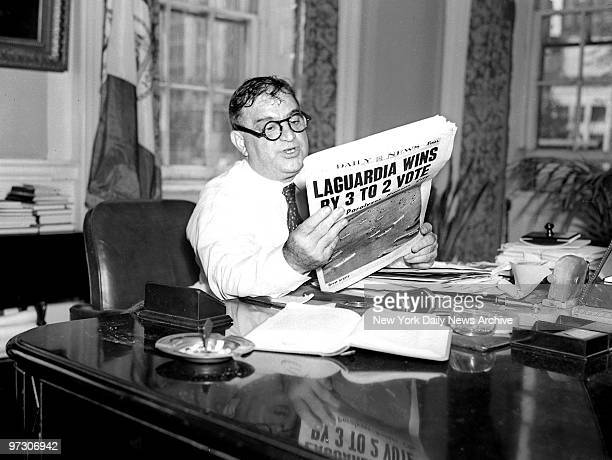 Mayor Fiorello LaGuardia reading the Daily News election results in 1941