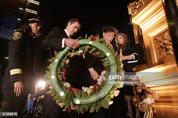 Mayor Gavin Newsom lays a wreath as he and survivors of the 1906 San Francisco earthquake take part in the 100th Anniversary ceremonies on the corner...