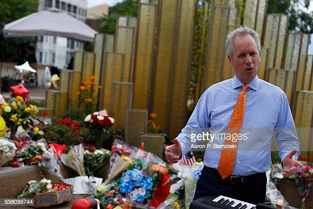 Mayor Greg Fischer speaks at a memorial following the death of boxing legend Muhammad Ali outside the Muhammad Ali Center June 4 2016 in Louisville...