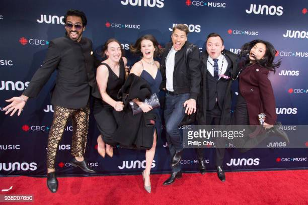 Mayor Gregor Robertson and his staff jump for joy at the red carpet arrivals at the 2018 Juno Awards at Rogers Arena on March 25 2018 in Vancouver...