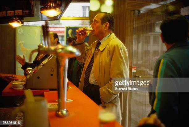 Mayor Jacques Chirac campaigning for reelection has a beer at the counter of a typical Parisian bar Chirac has been the mayor of Paris since 1977