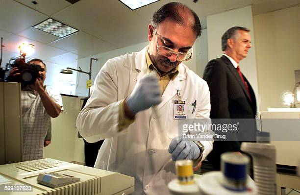 LA Mayor James Hahn right tours testing lab as DWP microbiologist Ronald Dergrigorian performs toxicity tests at the LADWP' testing facility in Sun...