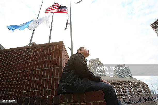 Mayor Janet Rago a homeless veteran living in the veterans' shelter across from Boston City Hall sits on the plaza and pay her respects after the...