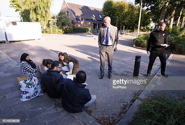 VOORSCHOTEN Mayor Jeroen Staatsen is seen speaking with refugees on Sunday On Friday night three buses with around 125 refugees arrived from the...