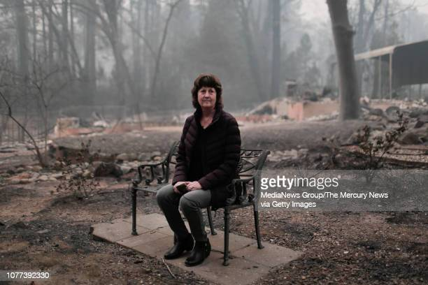 Mayor Jody Jones sits on a bench in the front yard of her home in Paradise Calif on Wednesday Nov 14 2018 Her house was burned during the Camp Fire