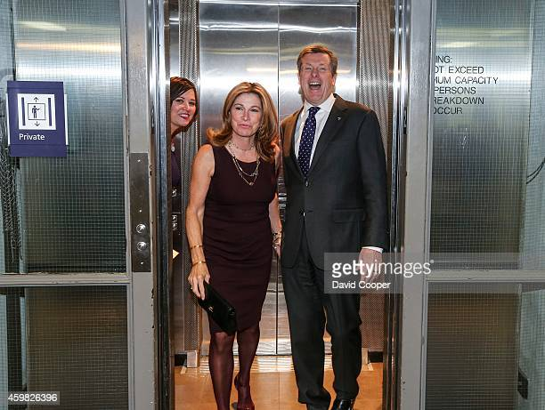 TORONTO ON DECEMBER 1 Mayor John Tory and his wife Barbara Hackett laugh at the media attention as they return to his new office from the private...