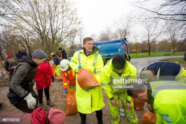 TORONTO ON MAY 5 Mayor John Tory filled some sandbags at Wards Island Toronto Mayor John Tory visited the Wards Island to see the flooding efforts...