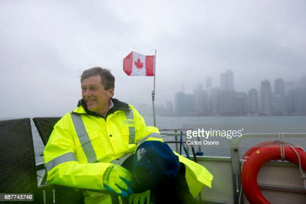 TORONTO ON MAY 5 Mayor John Tory rides a boat back to the mainland after visiting Wards Island Toronto Mayor John Tory visited the Wards Island to...