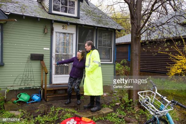 TORONTO ON MAY 5 Mayor John Tory spoke with Wards Island resident Alison Gzowski about the water levels around her home Toronto Mayor John Tory...