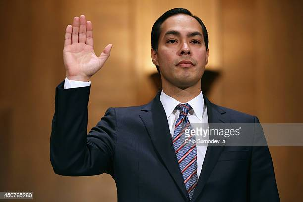 Mayor Julian Castro is sworn in during his confirmation hearing before the Senate Banking Housing and Urban Affairs Committee in the Dirksen Senate...