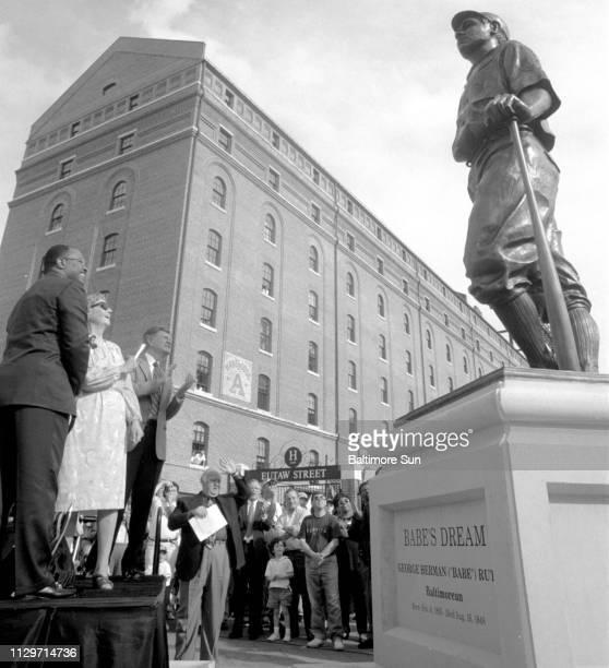 Mayor Kurt Schmoke Julia Ruth Stevens and John Steadman help unveil the statue of Stevens' father Babe Ruth at Camden Yards before a game against...