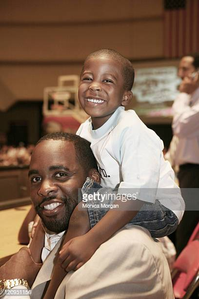 Mayor Kwame Kilpatrick with son Jonas during AND 1 Mix Tape Tour at Cobo Arena in Detroit Michigan United States