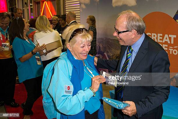 Mayor Len Brown right presents a volunteer with her certificate of appreciation during the New Zealand Blackcaps Welcome Home Reception at Queen's...