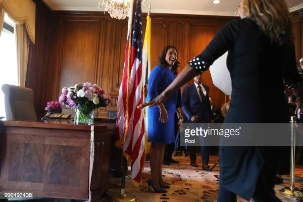 Mayor London Breed greets a well wisher in the receiving line after Breed's inauguration at City Hall July 11 2018 in San Francisco California