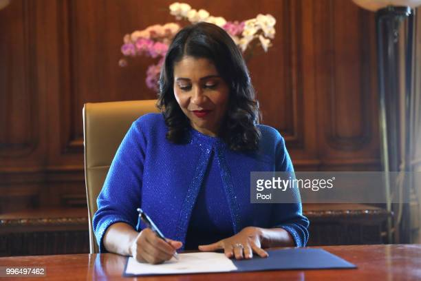 Mayor London Breed signs the oath of office after her inauguration at City Hall July 11 2018 in San Francisco California