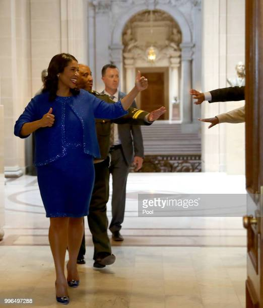 Mayor London Breed walks to her office following her inauguration ceremony July 11 2018 in San Francisco California