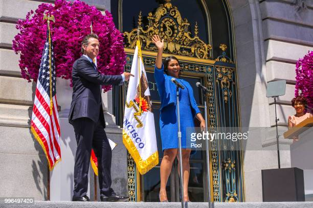 Mayor London Breed waves to the crowd moments after taking the oath of office during the inauguration outside City Hall July 11 2018 in San Francisco...