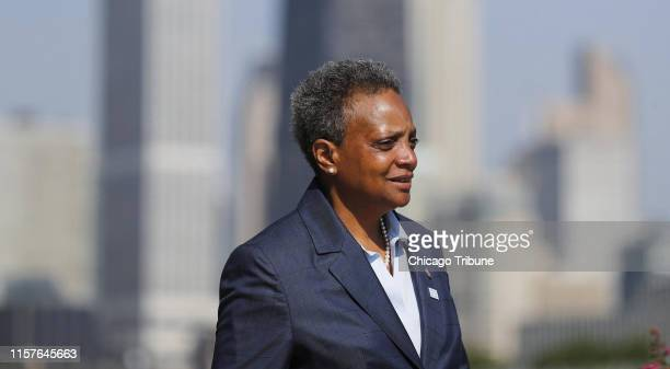 Mayor Lori Lightfoot speaks to the media regarding pausing the water meter program the before attending the Chicago Police Department graduation and...