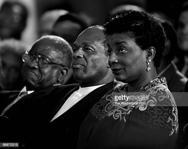 Mayor Marion Barry center his wife Cora and Control Board Chairman Andrew Brimmer listen as President Clinton unveils an economic rescue plan for the...