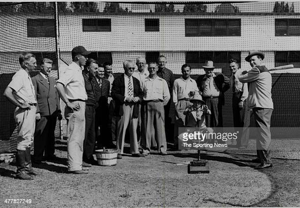 Mayor Merrill P. Barber, of Vero Beach, tries out the automatic Pitching machine at Dodgertown here during inspection of Brooklyn Dodgers facilities...