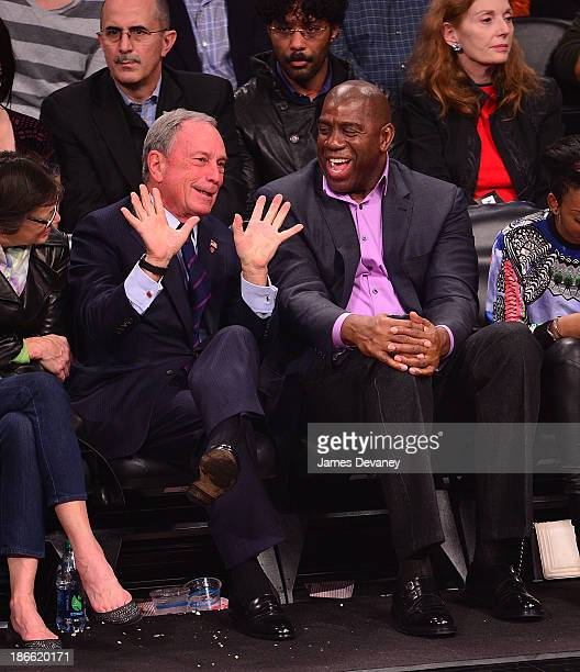 Mayor Michael Bloomberg and Magic Johnson attend the Miami Heat vs Brooklyn Nets game at Barclays Center on November 1 2013 in the Brooklyn borough...