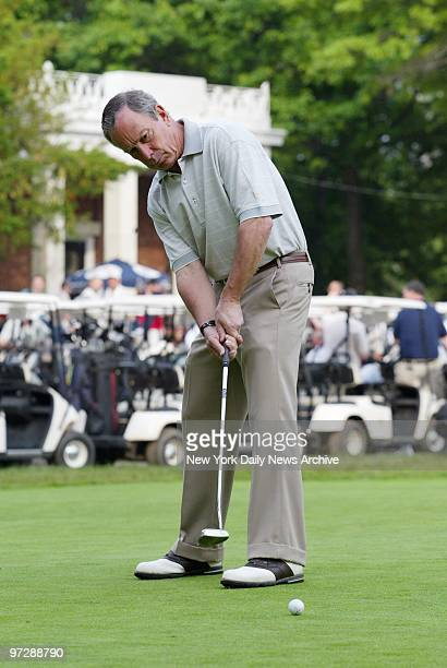 Mayor Michael Bloomberg keeps his eye on the ball at Split Rock Golf Course in the Bronx