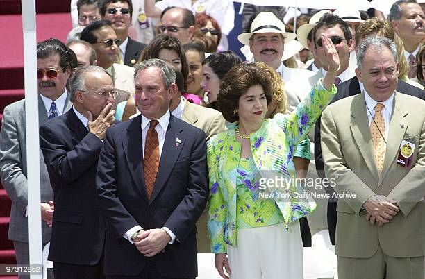 Mayor Michael Bloomberg stands with Puerto Rico's Gov Sila Calderon at a ceremony outside the Captiol Building in San Juan marking the 50th...