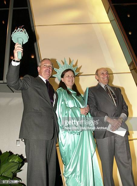 Mayor Michael Bloomberg takes hold of Miss Liberty's torch at the opening of the Westin New York at Times Square on W 43rd St and Eighth Ave They are...