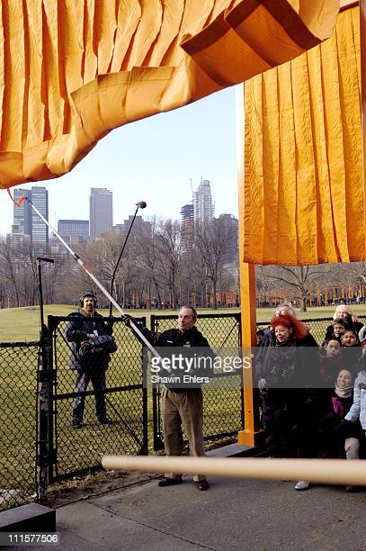 Mayor Michael Bloomberg unfurls The Gates by Christo and Jeanne Claude in Central Park in New York City on February 12 2005 The 23mile long pubic art...