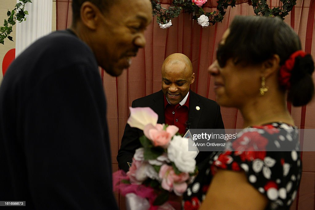 Mayor Michael Hancock marries Delani Eugene Simmons and Lavette Michelle Noel during a Valentine's Day marriage celebration at the Denver Clerk and Recorder's office. Couples applying for marriage licenses received gift bags containing gift certificates to local restaurants among other treats to celebrate their union.
