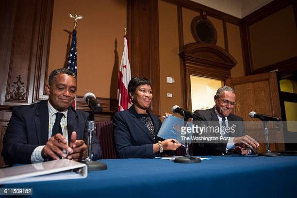 Mayor Muriel Bowser center US Attorney Channing Phillips right and DC Attorney General Karl Racine OAG left host a signing to transfer funds to the...