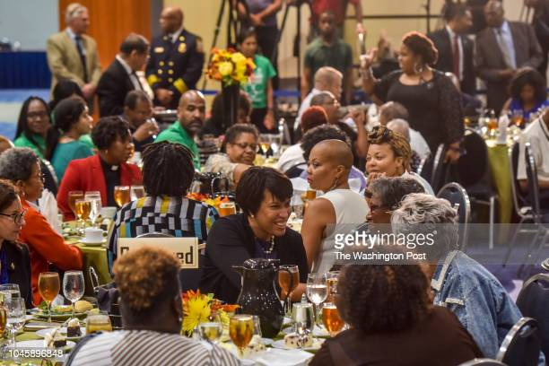 Mayor Muriel Bowser greets seniors displaced by the devastating fire at the Arthur Capper Senior Apartments during a luncheon hosted by the mayor at...
