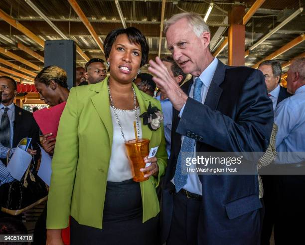 Mayor Muriel Bowser left and Council member Jack Evans talk while waiting for a press conference after announcing plans to build a sports arena at St...