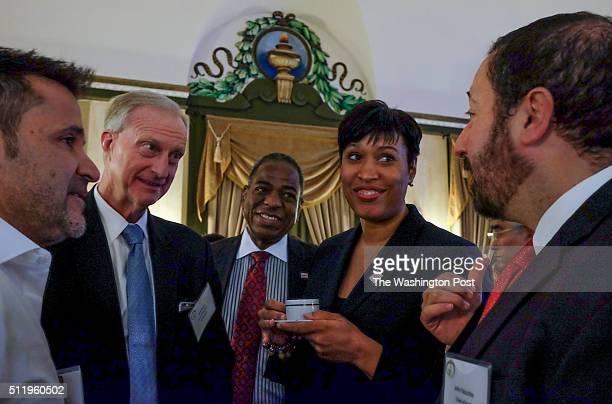 Mayor Muriel Bowser second from left confers with Edwin Villegas Jack Evans Vincent Orange and John Falcicchio following a speech in Havana Cuba on...