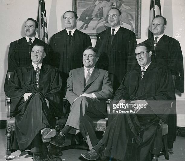 JAN 23 1954 JAN 24 1954 NOV 3 1954 Mayor Newton poses with municipal court judges who have joined judges of other courts located in Denver in wearing...