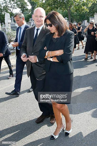Mayor of 4th District Christophe Girard and Mayor of Paris Anne Hidalgo attend the Designer Sonia Rykiel's Funerals at Cimetiere du Montparnasse on...