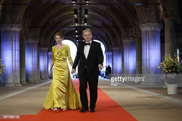 Mayor of Amsterdam Eberhard van der Laan and his wife attend a dinner hosted by Queen Beatrix of The Netherlands ahead of her abdication at...