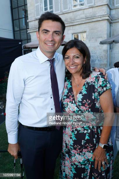 Mayor of Angouleme Xavier Bonnefont and Mayor of Paris Anne Hidalgo attend the 11th Angouleme FrenchSpeaking Film Festival Day One on August 21 2018...
