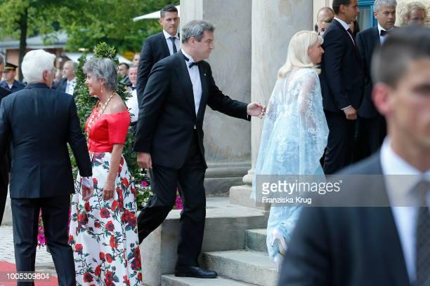 Mayor of Bayreuth Brigitte Merk-Erbe with husband Thomas Erbe and State Premier Markus Soeder next to his wife Karin Baumueller during the opening...